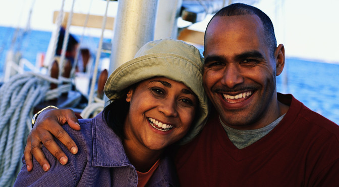 Couple Smiling Together on a Sailboat